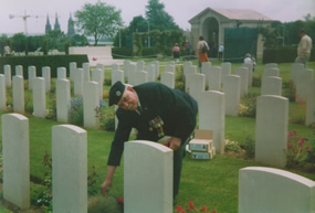 Len Butt Laying a wreath on the Grave of  Lt E.G.H. Phillips