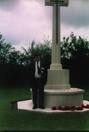 "Len Butt, Paying Respect at the Cross of Remembrance ""Jerusalem"" War Cemetary Normandy June 6th 2004"
